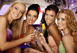 Women Celebrating in a Limousine
